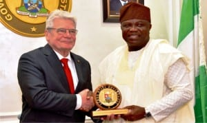 Governor Akinwunmi Ambodi of Lagos State (right), presenting a souvenir to the German President, Mr Joachim Gauck, during his visit to Lagos State, recently.