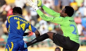 Keeper Femi Thomas (right) of Enyimba going for the ball