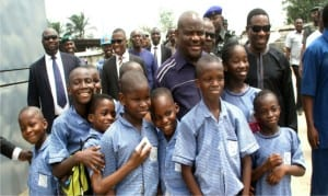 Rivers State Governor, Chief Nyesom Wike, with pupils of Santa Maria Nursery and Primary School in Port Harcourt shortly after inspecting work on the NLNG-Nkpogu bridge in Port Harcourt, on Friday.