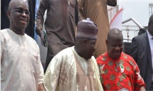Rivers State Governor, Chief Nyesom Wike (right), PDP National Chairman, Senator Ali Modu Sheriff (middle), and Ekiti State Governor, Ayo Fayose, during the special thanksgiving service organised by the PDP to celebrate Governor Wike's Supreme Court victory in Port at the Yakubu Gowon Stadium, Harcourt, on Saturday