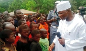 Comptroller General of the Nigerian Customs Service (ncs), Retired Col. Hameed Ali, (right), addressing some children in the Internally Displaced Persons (idps) Camp in Uhogua community, Ovia North East LGA in Edo State on Friday
