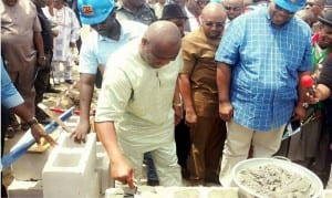 Rivers State Governor, Chief Nyesom  Wike (2nd left), laying the foundation stone of the second phase of Mile One Market in Port Harcourt, yesterday. With him are the Speaker, Rivers State  House of Assembly, Rt Hon Dabo Adams (2nd right) and Chairman, MCC, Senator John Mbata (right)