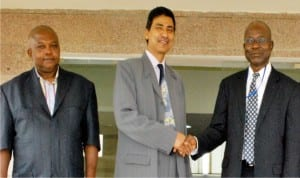 Counselor (Commercial and Project), High Commission of India, Mr Machender Kanyal (middle), welcoming The Chairman, Local Organising Committee (Loc) of the 2016 World Mayors-African Region Investment Conference, during the Committee's chairman working visit to the commission in Abuja on Tuesday. With them is the Conference Manager, Mr George Igoche.