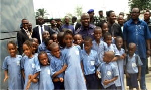 Rivers State Governor,  Chief Nyesom Wike with pupils of Santa Maria Nursery and Primary School in Port Harcourt shortly after inspecting work on the NLNG-NKPOGU Bridge on Friday