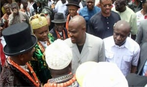 Rivers State Governor, Chief Nyesom Wike (2nd right), exchanging pleasantries with Obio/Akpor LGA traditional rulers, during the flagging off of the construction of four link roads in the area. Inset is Governor Wike driving  a grader to kick-start the roads construction.