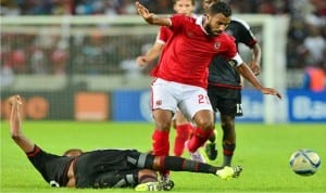 Captain of Al Ahly (2nd left) trying to go past an opponent in a recent game.