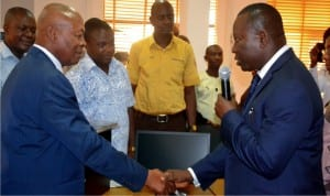 CEO, Charkin, Maritime and Safety Institution, Sir Charles K. Wami (right) in a hand shake with the Vice Chancellor RSUST Prof. Blessing Didia shortly after donating some sets of desk top computers to the department of maritime of RSUST last Wednesday. With him are departmental staff of the  institution.                         Photo: Nwiueh Donatus Ken