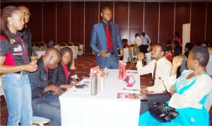 Airtel High Value Sales Executive, Mr Okogbue  Nnamdi (3rd right), attending to some participants  at  the association of Chartered Certified Accountants  (Acca),  2016 Nigerian Summit in Abuja  recently