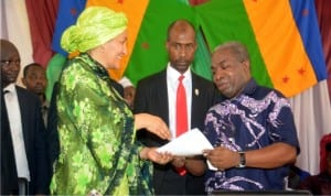 The MOSOP President, Mr Legborsi Piagbara (right) present his welcome address to the Hon Minister for Environment, Amina Muhammad (left) during her visit to Ogoni on Federal Government on clean-up of Ogoniland  recently.
