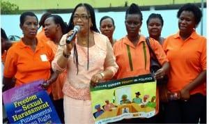 Mrs. Atosemi Teetito (2nd left) Perm Sec, Ministry of women affairs addressingNawoj member during a peace walk to comemorate international women's day in Port Harcourt. Ibioye Diama
