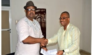 Former General Manager, Rivers State Newspaper Corporation, Mr Celestine Ogolo (right), handing over to his successor, Chief Soye Wilson-Jambo at the corporation, yesterday