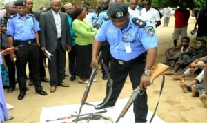 Plateau State Commissioner of Police, Mr Adekunle Oladunjoye displaying weapons recovered from suspected criminals in Jos on Tuesday