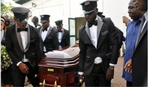 Undertakers carrying the coffin bearing body of the late Minister of State for Labour and Employment, Mr James Ocholi at the National Hospital in Abuja to his home town in Kogi State on Wednesday