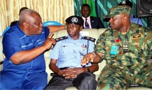 L-R: Resident Electoral Commissioner, Inec Rivers State, Mr Aniedi Ikoiwak;Rivers State Commissioner of  Police, Musa Kimo and Commander 97 Special Operation Group, Nigerian Air Force Port Harcourt, Air Commodore Charles Onwo during a meeting with politicians and candidates for the 19th March  Re-run Election in Port Harcourt on Wednesday.