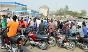 Commercial motorcyclists queuing to purchase  petrol at a filling station in Madalla, as scarcity  of the commodity continues in Niger, recently.