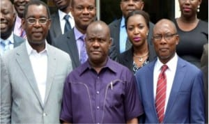 L-R: Rivers Commissioner for Justice and Attorney General, Mr Emmanuel Aguma (SAN), Rivers State Governor, Chief  Nyesom Wike  and Chairman, Nigeria Bar Association, Port Harcourt branch, Mr Denis Okwakpam, after the governor's inauguration of the Local Organizing Committee for the 2016 NBA Conference in Port Harcourt on Wednesday
