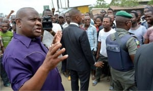 Rivers  State Governor, Chief Nyesom Wike (left) , addressing people of Etche, during his inspection tour of  on-going road reconstruction project at Etche-Chokocho Road in  Etche Local Government of Rivers State recently