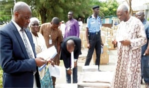 Federal Capital Territory INEC Resident Electoral Commissioner, Mr Jacob Jatau inspecting the sensitive election materials for the forthcoming Area Council elections in Abuja, yesterday.