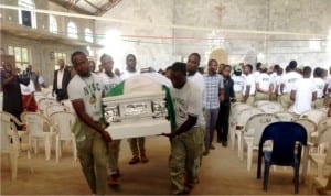 Nysc Corps members carrying the casket bearing the remains of their colleague, Chukwudumebi Okonta who was killed during the last Rivers rerun elections after a requiem mass at Holy Family Catholic Church Ajaji Illah, Oshimili North LGA, Delta State last Friday