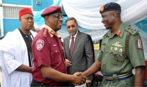 L-R: Manager Government And Business Relations, Mobil Producing Nigeria, Mr Nigel Cookey-gam; FRSC Corps Marshal, Boboye Oyeyemi and Representative of Secretary to Government of the Federation, Dr Ray Ugo, cutting a tape during the commencement of Pan Nigeria Road Safety Campaign in Abuja recently.