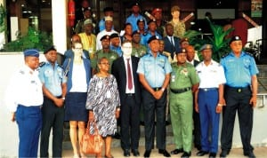 i-g Solomon Arase (4th right), Director of Operations, ineqe Group, Mr Gary White, Head, West Africa Conflict, Stability and Security, Catherine Weiss (3rd left), and other top security officers at a roundtable discussion on security  stabilisation in Abuja, recently.