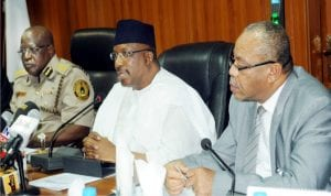 L-R: Comptroller-General of Immigration, Mr Martin Abeshi, Minister of Interior, Lt.-Gen. Abdulrahaman Dambazau and Permanent Secretary, Minstry of Interior, Mr Bassey Akpanyung, at the Strategic Stakeholders Meeting on Pastoralist  and Sedentary Farmers Conflict in Nigeria in Abuja on Thursday