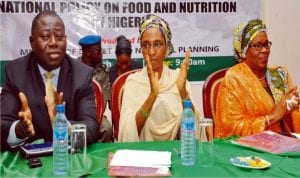 Director, Macroeconomic Analysis, Federal Ministry of Budget and National Planning (left) with Minister of State for Budget and National Planning, Mr Tunde Lawal, Hajia Zainab Ahmed at the National Stakeholders Dialogue on National Policy on Food and Nutrition in Abuja, recently.