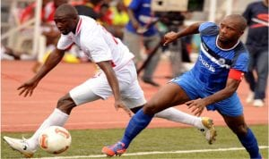 Enyimba captain, Chinedu Udoji (right) trying to stop an opponent in a match. He and his mates must be on their toes against Etoile du Sahel, today
