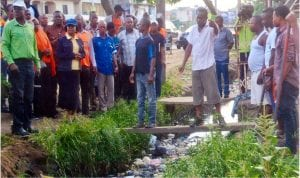 State Commissioner for Environment, Prof. Roseline Konya (3rd left), inspecting the Amadi-Ama gutter covered with dirts, during one of the monthly Sanitation exercises in Port Harcourt. Photo: Chris Monyanaga
