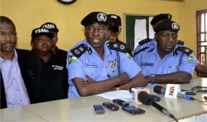 Commissioner of Police Rivers State Command, Mr Musa Kimo (middle) addressing journalists during a press briefing on recovery of cars, amununition of all kinds at Special Anti-Robbery Squad (SARS) office  Rukpokwu  in Obio/Akpor Local Government Area. With him are A. A. Muhammad  (right) and other SARS officer.                                                                                                                                                            Photo: Nwiueh Donatus Ken
