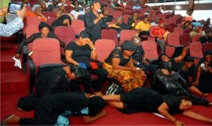 Widows from Tai Local Government Area of Rivers State on the floor crying for their husbands and children killed by soldiers at Tai during the March 19 rerun elections in Rivers State.Photo: Chris Monyanaga