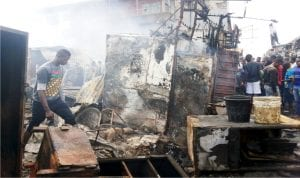 Scene of fire incident at a section of Ladipo Auto Market in Mushin, Lagos State, on Wednesday