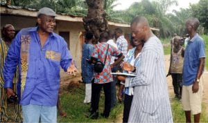 The owner of Ardis Farm, Chief Ayodele Adigun (left), speaking with newsmen over invasion of the farm by armed robbers in Lagun  Lagelu local government area of Oyo State recently.