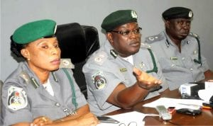 L-R:Acting Deputy Comptroller of Customs in charge of Revenue, Mrs Elizabeth Isofi, Customs Area Comptroller Oyo/Osun Area Command, Mr  Temitope Ogunkua and Deputy Comptroller  (Adm), Mr Abdulsalam Hassan, at a news conference on the activities ot the Command, recently.