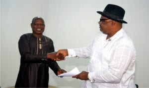 Acting General Manager Rivers State Newspaper Corporation,  Soye Wilson-Jamabo (right) receiving an address from the Chairman Nigeria Union of Journalists, Tide Chapel, Mr Felix Okogbule, during the management  meeting with the Unions, yesterday.  Photo:Chris Monyanaga
