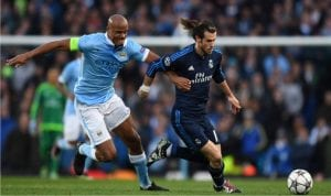 Manchester City captain (left), in a tussle with Gareth Bale in their first semi-final march at the Etihad Stadium, yesterday