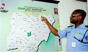 Police officer in charge of Nigeria Police Force Complaint Response Unit, CSP Abayomi Shogunle (right), explaining the Police Force Complaint Response Areas to newsmen during journalists' visit to Police Headquarters in Abuja last Saturday.