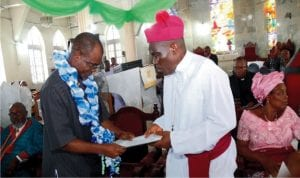 Senior Special Adviser on Security to the Deputy Governor Dr. (Mrs) Ipalibo Harry Banigo, Elder Emmanuel Ibama, presenting address to the Bishop, Niger Delta Diocese Rev. Ralph Ebirien at the 2nd Session of the 22nd  Synod of the Diocese at St Augustine Anglican Church, Abonnema in Akuku-Toru Local Government Area.