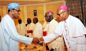 President Muhammadu Buhari (left) in a handshake with  Archbishop Anthony Obinna of Owerri Catholic Diocese during a meeting of the President with the leadership of Catholic Bishops' Conference of Nigeria at the Presidential Villa Abuja last Monday
