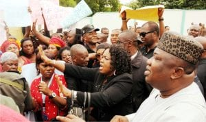 Gov. Ifeanyi Ugwuanyi of Enugu State (right), addresing a coalition of women groups during a protest over recent attack on people by herdsmen in Enugu on Tuesday.
