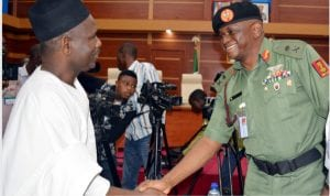 Representative of the Chief of Defence Staff, Maj.-Gen. Fatai Ali (right), welcoming the team  leader,  Miyetti Allah Cattle Breeders Association of Nigeria,  Senator Alkali Jajare, to a meeting on finding  a solution to the Herdsmen and Farmer Crisis at the  Defence Headquarters in Abuja on Wednesday