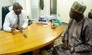 Governor Muhammadu Jibrillah of Adamawa (left), discussing with the Acting Managing Director, News Agency of Nigeria (Nan), Mr Jones Afolabi, during a courtesy visit to the Governor at the Government House, Dougirie Inyola recently