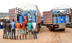 Men suspected to be diverting petroleum products arrested and paraded with their products by the Nigeria Security and Civil Defence Corps in Ibadan, recently.