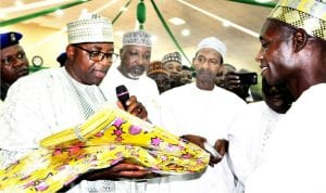 Governor Muhammed Abubakar of Bauchi State (left), presenting relief materials  to Chairman, Bauchi Local Government Area, Alhaji Ado Aska, during the commencement of distribution of Federal Government's relief materials to Idps in Bauchi State on Monday