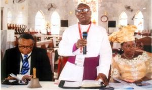 Bishop, Diocese of Okrika/Synod President, Rt. Revd. Tubokosemie R. Abere (middle), reading a presidential address, during the 1st session of the 5th Synod at Bethel Anglican Church, Amadi-Ama, Okrika North Archdeaconry recently. With him are the Chancellor, Diocese of Okrika, His Lordship Justice Sika Henry Aprioku (left) and the wife of the Bishop, Diocese of Okrika, Mrs Zipporah T. Abere Photo: Egberi A. Sampson