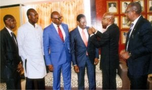 Rivers State Commissioner for Information and Communications, Dr Austin Tam-George (3rd right), being decorated with the emblem of the Ijaw Professional Association (IPA) by the Vice President of the association, Mr Geoffrey Kwale (2nd right), during a courtesy visit to the commissioner in Port Harcourt, yesterday. With them are members of the association