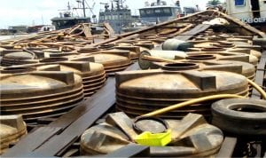 Two Cotonou bound boats laden with products suspected to be illegally refined *Automotive Gas Oil* (Diesel ) concealed in plastic tanks at the Warri Naval Base in Delta recently.