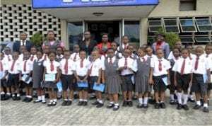 Pupils of Ash-Merlyn International School, Port Harcourt, in a group photograph, during an excursion visit to Rivers State Newspapers Corporation, publishers of The Tide newspapers in Port Harcourt, yesterday                      Photo: Ibioye Diama