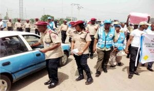 Unit Commander of Rs5.31 Onitsha Unit Command, Mr Paulinus Akpotobo (left)  and other Frsc personnel, during the 2016 West African Road Safety Organization Day campaign in Onitsha on Tuesday