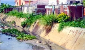 The Mtawargba Creek covered with grass at the Woke Lane, GRA in Port Harcourt.
